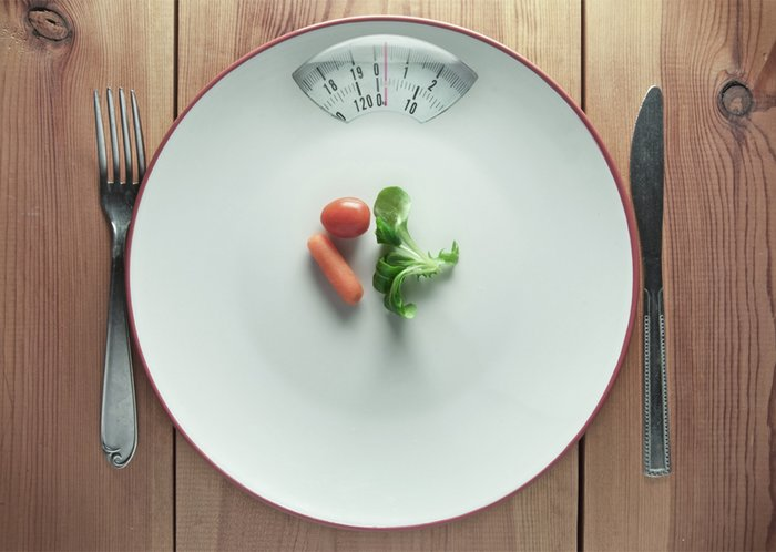A nearly empty plate with a scale.